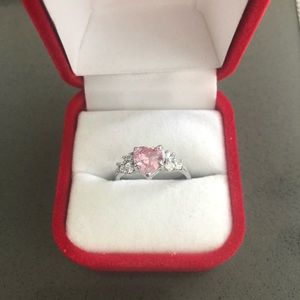 Silver ring with pink heart cut stone